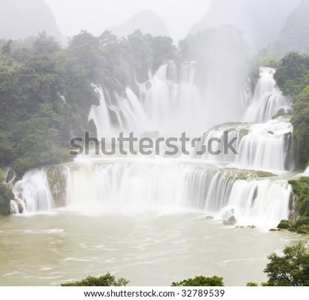 The waterfall in fog.The great detian waterfall, Guangxi,China - stock photo