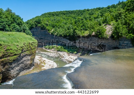The waters of the Genesse River fall downward into the Middle Falls of Letchworth State Park, New York. - stock photo