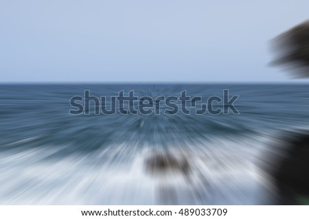 The waves beat against the rocks - the motion blur in the photo. Beautiful background.