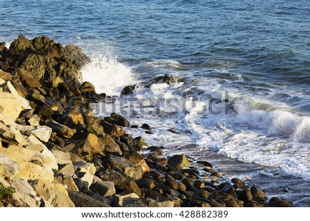 The waves of the Pacific ocean, the beach landscape. The ocean and waves during strong winds in United States, Santa Monica. Waves breaking on the rocks. - stock photo