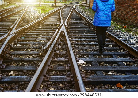 The way forward railway,girl walking - stock photo