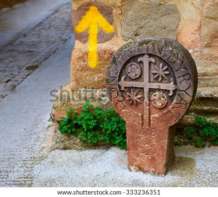 The way of Saint james yellow arrow sign in Cirauqui Pamplona Spain