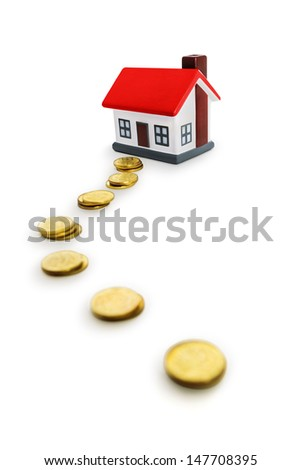 The way to the house -Coins and house - stock photo