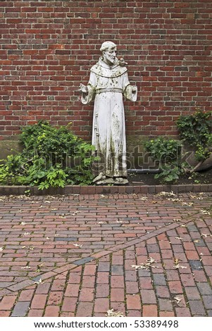 The weather-worn statue of a saint in a courtyard near the Old North Church in the North End of Boston, Massachusetts