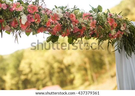 The wedding archway with flowers