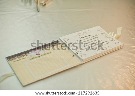 The wedding book for record of desires from guests to the newly-married couple. - stock photo