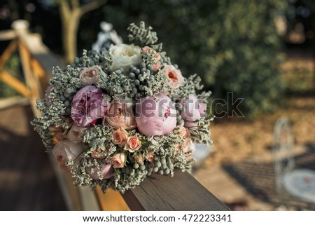 The wedding bouquet stands on the balcony
