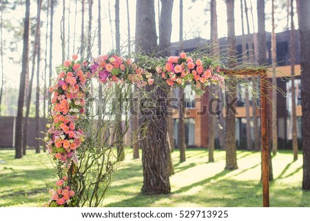 The wedding ceremony in the woods in the rustic style. Wedding Arch closeup.