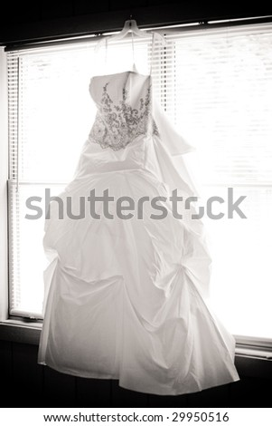 the wedding dress against the window - stock photo