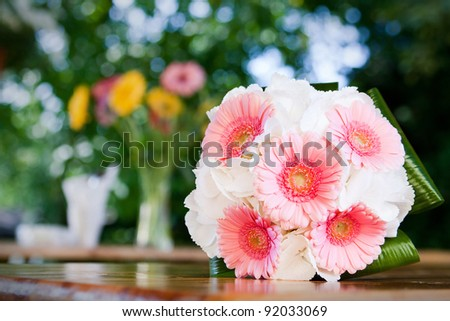 the wedding flowers on table - stock photo
