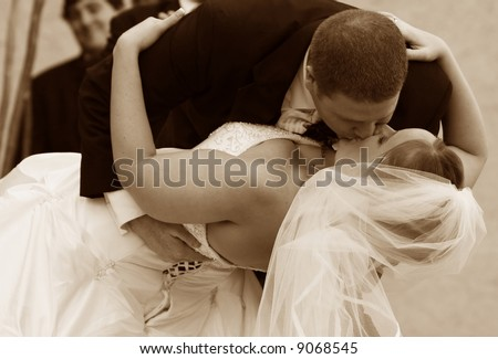 The wedding kiss at a traditional ceremony in the united states - stock photo