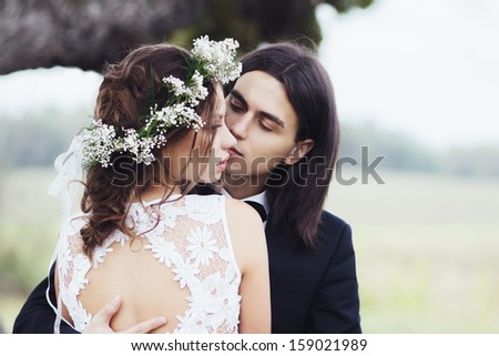 The wedding of a young couple outdoors - stock photo