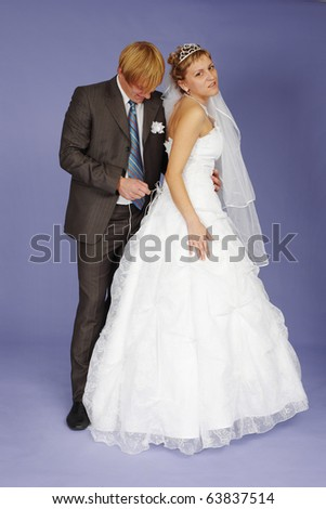 The Wedding re-enactment on a blue background - stock photo
