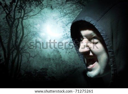The werewolf in forest - stock photo