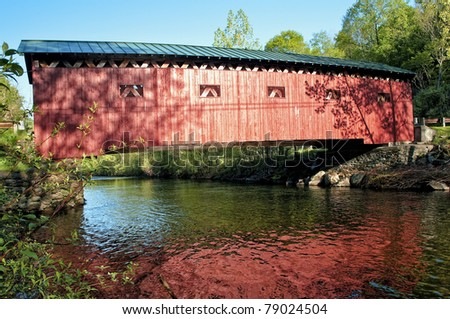 The West Arlington Covered Bridge which spans the Battenkill River in Arlington, Vermont - stock photo