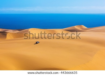 The west coast of the Atlantic Ocean. Giant moving sand dunes. Sandwich Harbour - part of Namib-Naukluft National Park - stock photo