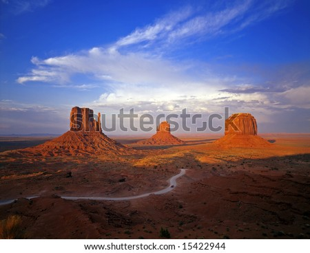 The West Mitten Butte, East Mitten Butte and Merrick Butte formations, located in Monument Valley Navajo Tribal Park, Arizona. - stock photo