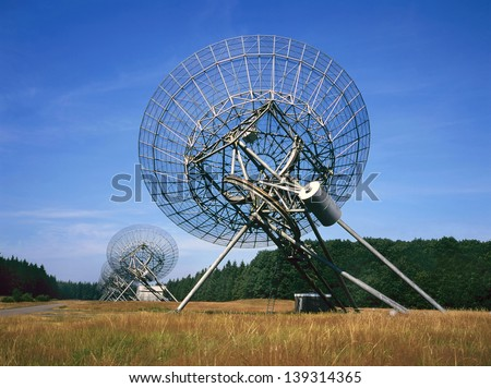 The Westerbork Synthesis Radio Telescope (WSRT) in the Netherlands is an aperture synthesis interferometer that consists of a linear array of 14 antennas arranged on a 2.7 km East-West line. - stock photo