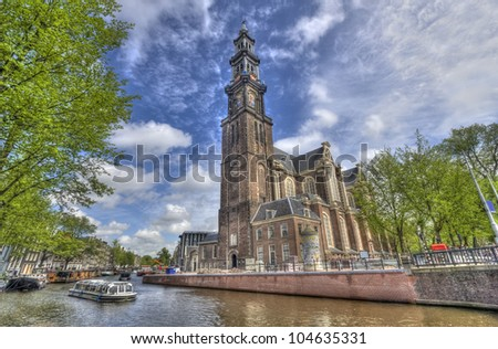 The Westerkerk church and a tourboat in Amsterdam, Holland - stock photo