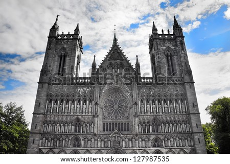 The western facade of a cathedral in Trondheim, Norway, with a considerable quantity of sculptures with the image sacred, kings and bishops - stock photo
