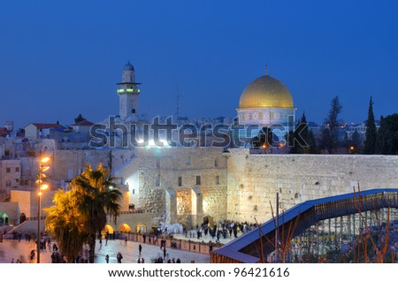 The Western Wall, is the remnant of the ancient wall that surrounded the Jewish Temple's courtyard in jerusalem, Israel. Dome of the Rock is a Muslim Shrine located on the Temple Mount. - stock photo