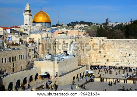The Western Wall is the remnant of the ancient wall that surrounded the Jewish Temple's courtyard in jerusalem, Israel. Dome of the Rock is a Muslim Shrine located on the Temple Mount. - stock photo