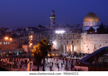 The Western Wall is the remnant of the ancient wall that surrounded the Jewish Temple's courtyard in jerusalem, Israel. Dome of the Rock is a Muslim Shrine located on the Temple Mount itself. - stock photo