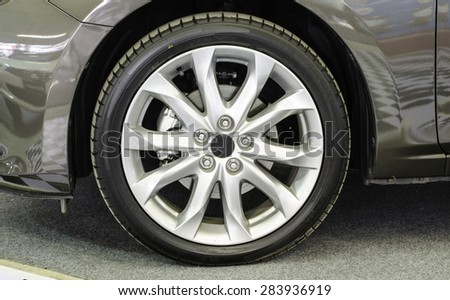 the wheel of a modern sports car - stock photo