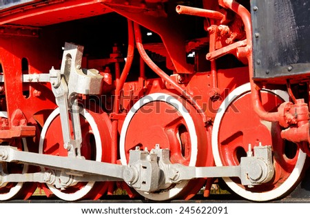 The wheels of an old steam engine. - stock photo