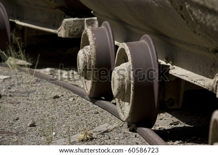 the wheels of old mine cart - stock photo