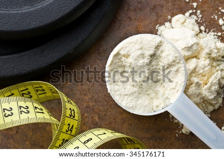the whey protein in scoop  - stock photo