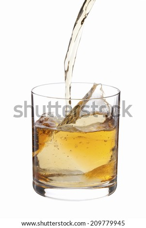The Whiskey Pouring Into The Lock Glass