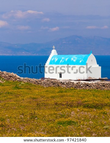 The white and blue church of the family background of the sea. Typical for Greece. - stock photo