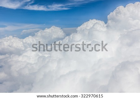 The white big fluffy clouds with magic shape in the blue sky, beautiful cloudscape. - stock photo