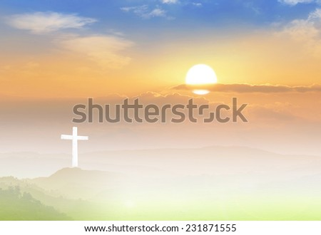 The white cross on sunset background. - stock photo