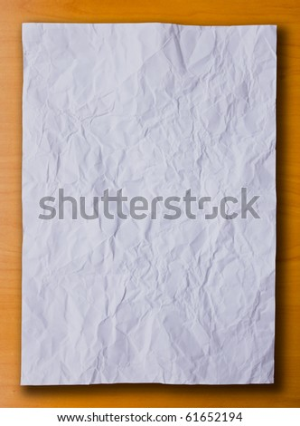 The white crumpled paper on the white background
