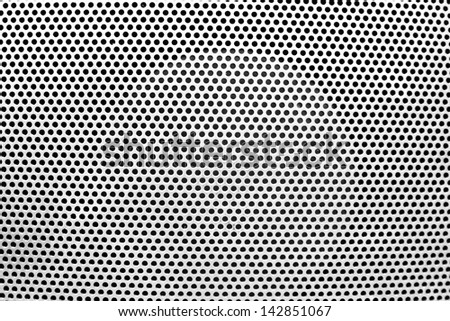the white grate background with holes