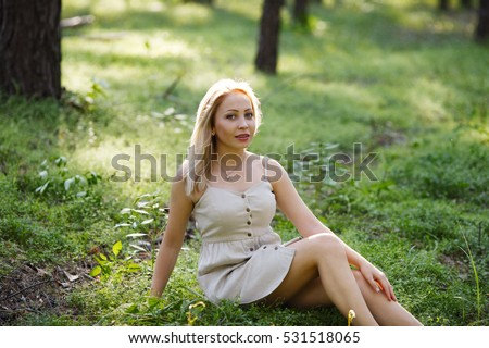 stock-photo-the-white-haired-girl-walks-in-the-woods-without-shoes-the-sun-is-green-grass-forest-531518065