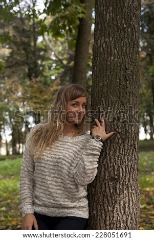 The white-haired young beautiful girl on a background of nature. - stock photo
