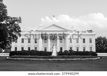The White House in black and white - The official residence of the President of the United States in Washington, D.C. lit by the setting sun in the evening. Black and white image. - stock photo