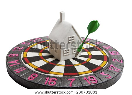 The white house in the center of the target with the dart - stock photo