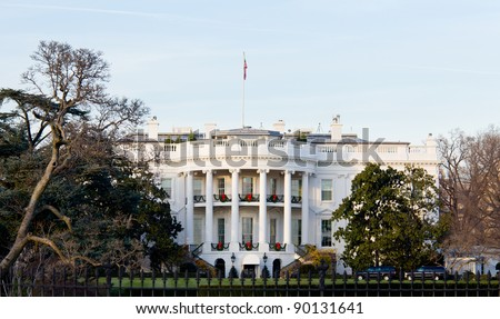 The White House in Washington DC at Christmas as the tree is decorated - stock photo