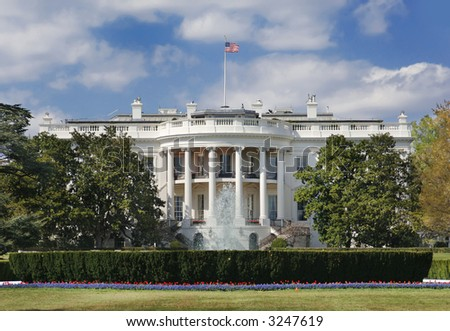 The White House in Washington DC on a partly cloudy afternoon in spring - stock photo