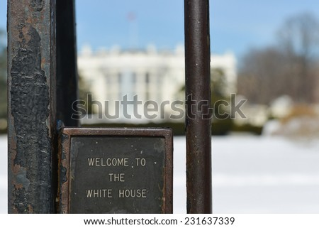 "The White House in Winter with ""Welcome to White House"" print on the fences in focus - Washington DC, United States of America - stock photo"