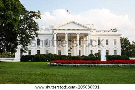 The White House - The official residence of the President of the United States in Washington, D.C. lit by the setting sun in the evening. - stock photo