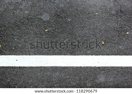 The white line painted on road - stock photo