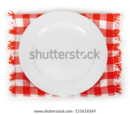 the white plate on checkered tablecloth - stock photo