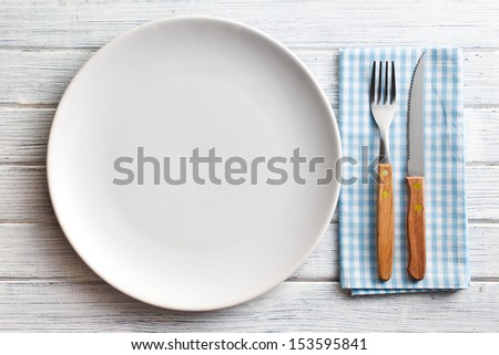 the white plate with fork and knife - stock photo