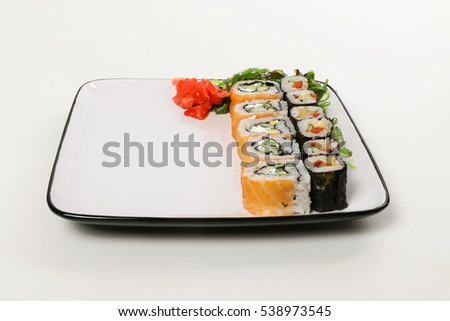 The white plate with mix sushi rolls and chukka and ginger, isolated