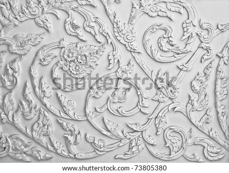 The White stucco design of native thai style on the Wall - stock photo